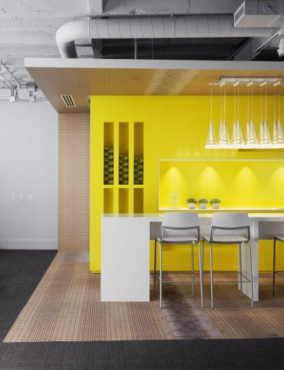 At the opposite of the last one, this decor is contemporary in every way. The yellow accent wall brings warmth to the concrete room.
