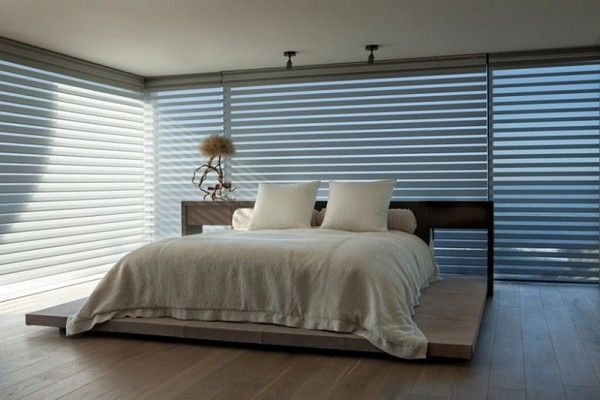Bedroom with blinds for glass doors