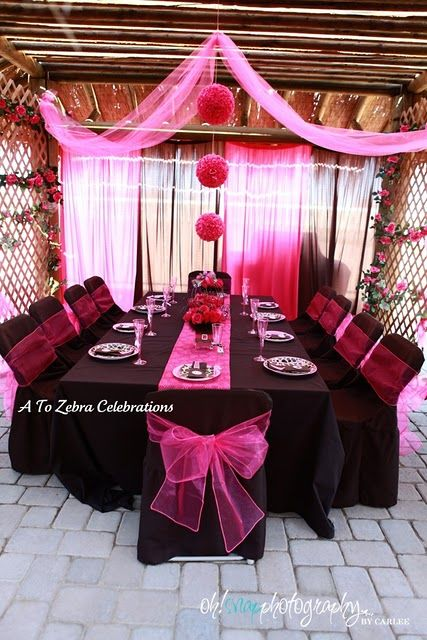 the balls hanging over the table are styrofoam with fake roses hot glued on-really pretty all together with the black chairs and pink bows