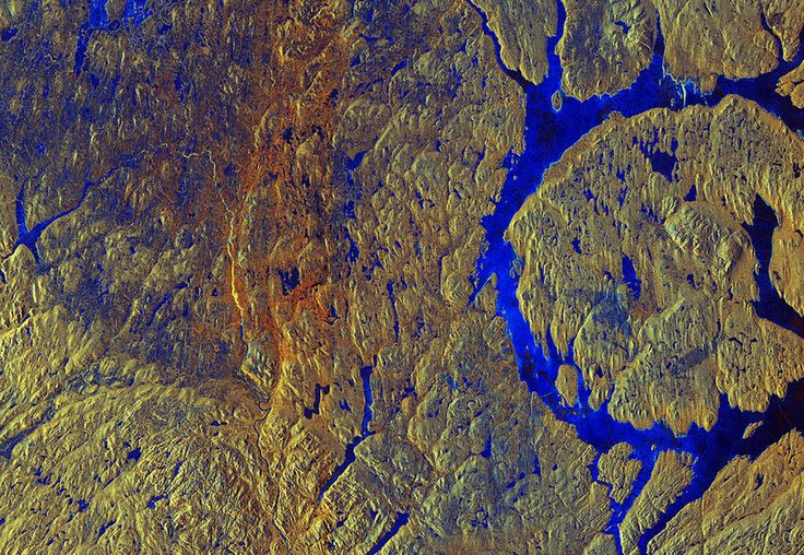 From space, Earth is living art. - Canada's Manicouagan Crater, which was created by an asteroid strike. In this false-color radar image, the blue is areas of ice and water and the yellows and oranges are vegetation. (Photo: ESA)