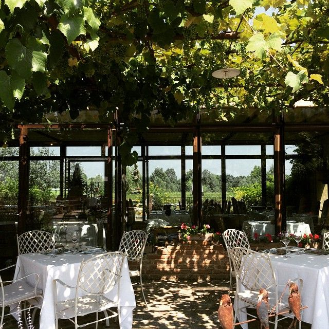 The picturesque al fresco dining area at Antica Corte Pallavicina in Parma, Venice. When Massimo Spigaroli bought this 14th-century castle, goats and cows lived in the parlours, enjoying frescoes as well as shelter.
