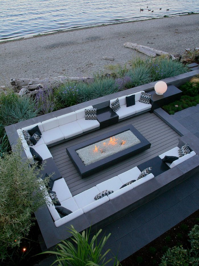 Contemporary Seaside Garden Patio Deck with Custom Benchs and Fire Pits
