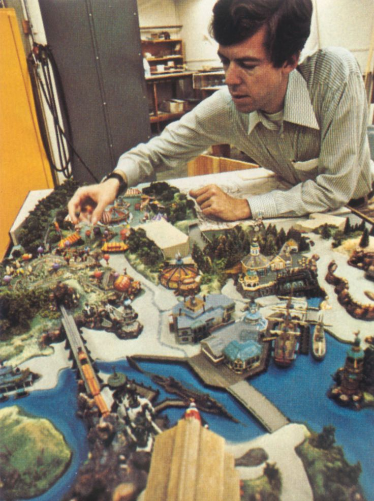 1970s: Walt Disney Imagineer Tony Baxter with a model of Discovery Bay and Dumbo's Circus for Disneyland
