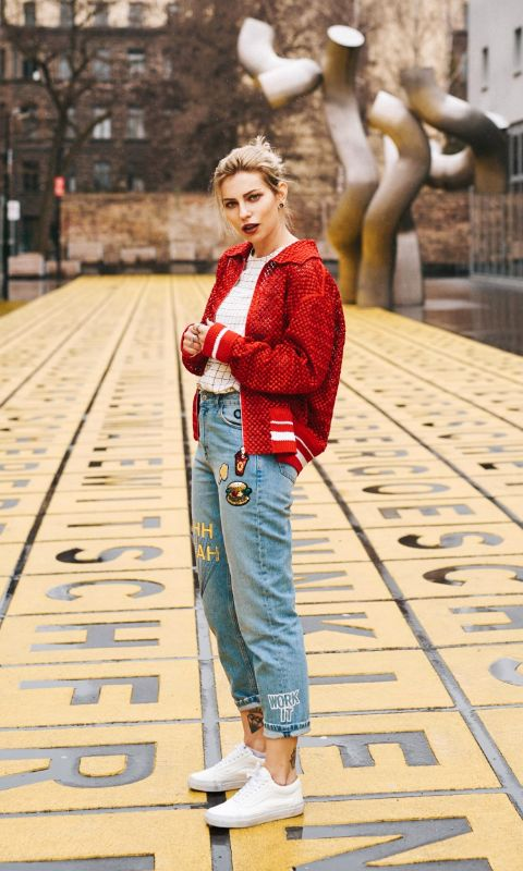 35 Fall Jean Outfit Ideas to Copy | patched baggy denim, white sneakers, and a sporty red bomber