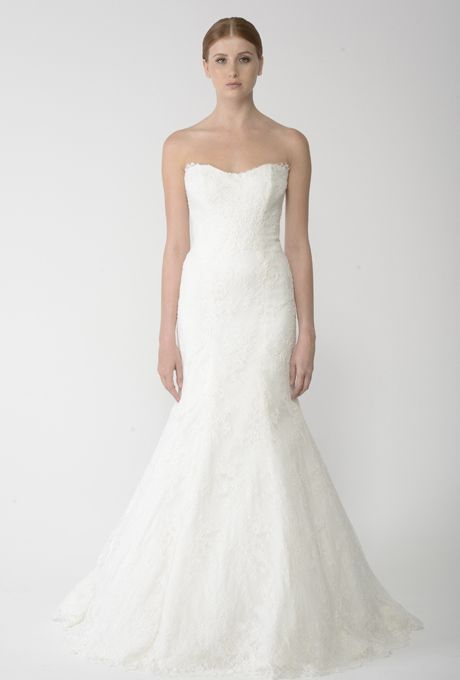 Brides: Bliss by Monique Lhuillier. Ivory re-embroidered lace strapless sweetheart neckline trumpet gown.��More Details From Bliss by Monique Lhuillier