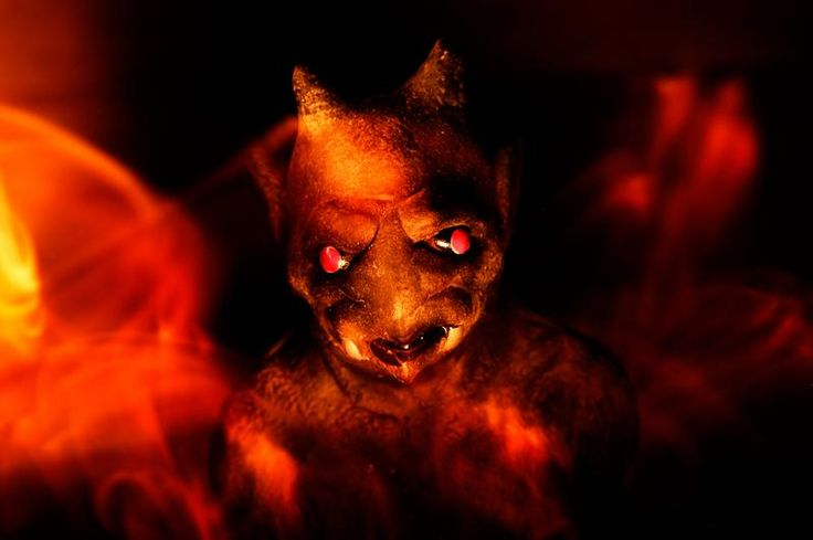 Chupacabra Images -- The gargoyle stood out at night like a firey demon from hell.