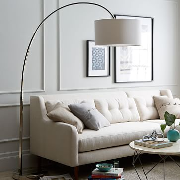"Overarching Floor Lamp - Polished Nickel  $299.00  (60""w x 19""d x 77""h)  -  You could do one of these, but they are dominant in the room!!!  Very dominant.  I would do this in the version where you don't have a table with a lamp in front of the bay window."
