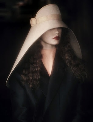 Photographer: Sheila Metzner.  Model: Kelly Mittendorf.  Gray magazine, S/S 2012. Hat by Balenciaga.