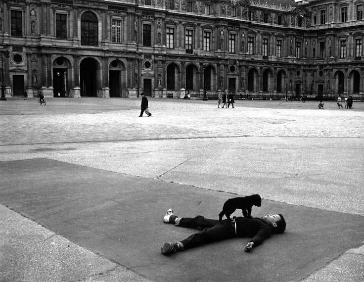 Robert Doisneau. Boy and Puppy. Square Patio, The Louvre. Paris 1969