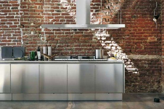 Stainless Steel Kitchen Cabinets...imagine against concrete wall with huge black iron windows...or dark oak panels