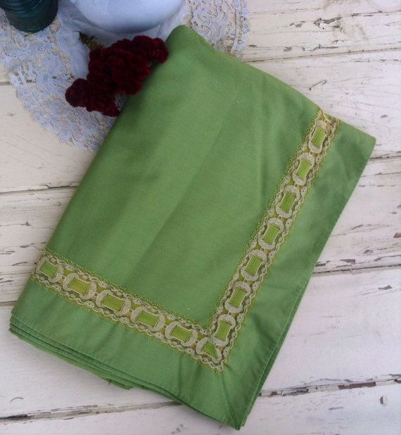Check out this item in my Etsy shop https://www.etsy.com/listing/254526649/vintage-green-holiday-tablecloth-with