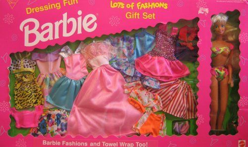 "Dressing Fun Barbie Lots of Fashions Gift Set - Easy To Dress (1993 Arcotoys, Mattel) by Arcotoys, Mattel. $159.99. Easy To Dress Dressing Fun Barbie Lots of Fashions Gift Set is a 1993 Arcotoys, Mattel production. Model #9518. Included in the box is a Barbie doll that's approx. 11.5"" tall with long bond hair & blue eyes. Barbie wears a green w/yellow, red & pink 2 Piece Bathing Suit and comes with a pink Towel Wrap, green Hairbrush and these Fashions: There's a yellow & black S..."