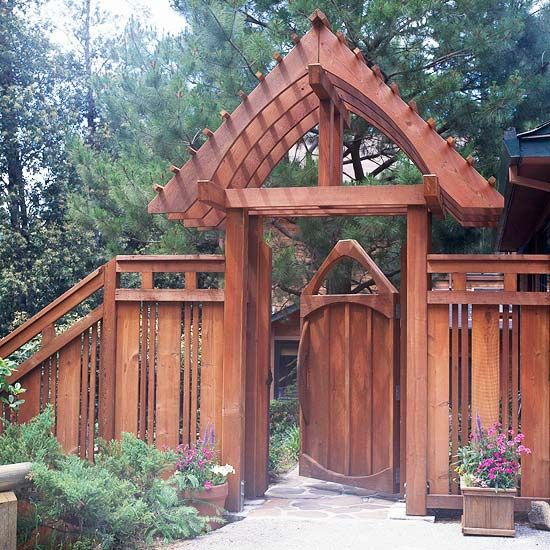 An oversized arbor with a gate can make a very dramatic appeal. The dark tones of the wood blend in beautifully with the woodsy atmosphere, with the trees behind offering both shade and privacy. This Asian-influenced arbor has excellent craftsmanship, and the wooden structure enhances the earthy appeal of the outdoor décor.