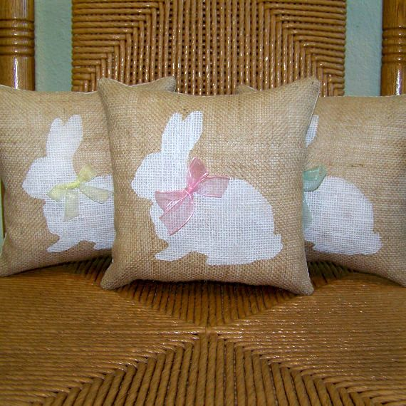 This fun little Bunny will make any room in the house feel like spring! Made from burlap fabric hand stenciled in white and lined in muslin fabric and tied in a chiffon ribbon at the neck. The backing is a solid muslin fabric on (approx.) 9 x 9, 12 x 12, and 14 x 1 4. Poly fiber fill stuffing and ready to display. Sizes 16 x 16 and 18 x 18 are pillow covers only.  **If you dont see the quantity you need please feel free to contact me and I will check current inventory for you.  *Burlap is…