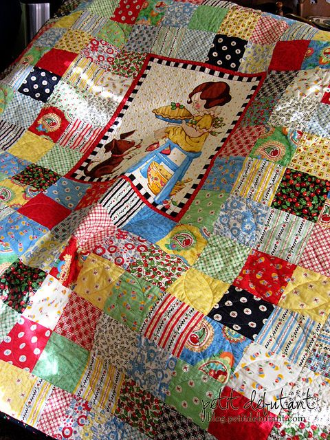 I love all the fabric and colors in this quilt, plus a little Mary Englebright makes me smile.