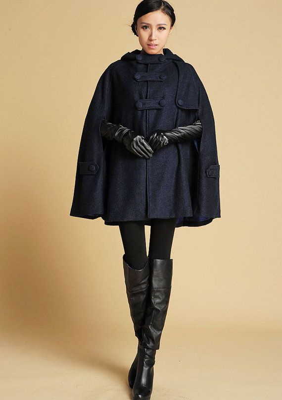 You will be warm in style this winter with this made-to-order warm wool cape from Xiaolizi. Show in dark blue, the extra large covered buttons add