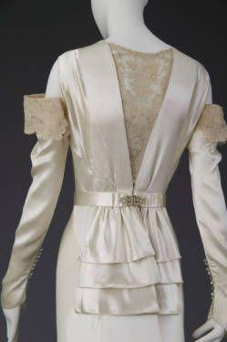 Wedding dress, 1934.  Silk satin, lace, rhinestones, pearls. Madame Marguerite, Chicago.  Gift of Mrs. Edward Byron Smith. Back detail