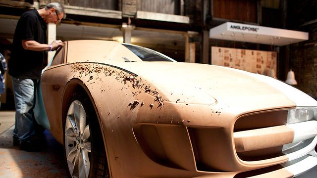 Jaguar clay modelling at Clerkenwell Design Week 2012 by Dezeen. In this movie Dezeen filmed at Clerkenwell Design Week earlier this year, Jaguar clay modeller Charles Douglas explains the importance of his role in the process of car design.