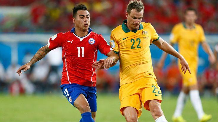 Alex Wilkinson of Australia controls the ball against Eduardo Vargas of Chile