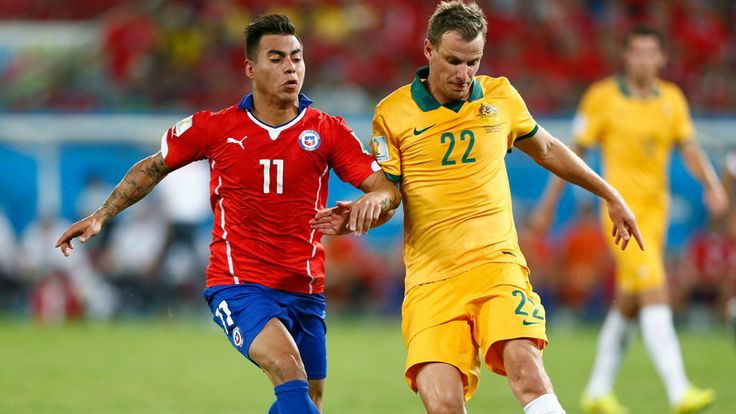 Alex Wilkinson of Australia controls the ball against Eduardo Vargas of Chile