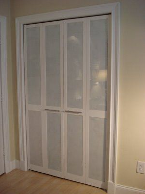 The louvers in a set of bi-fold doors have been replaced with panels of frosted plexiglass.