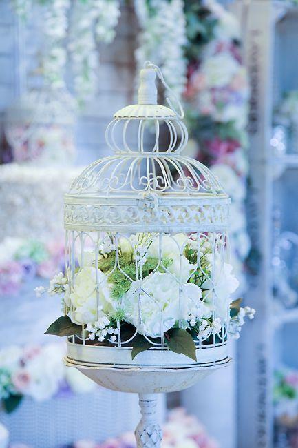 Gorgeous wedding decor! Bird cage with flowers.