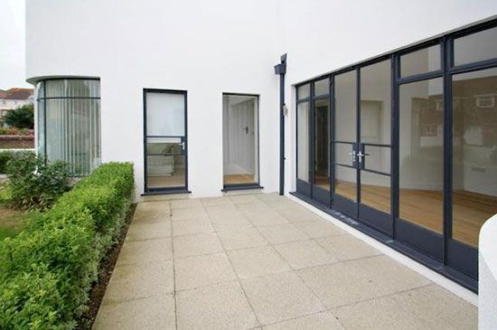 Ground floor apartment in the 1930s art deco Manor Road Garage in East Preston, West Sussex