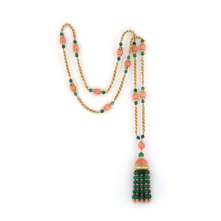 VAN CLEEF & ARPELS. A CHRYSOPRASE, CORAL AND DIAMOND SAUTOIR Designed as a yellow gold twisted ropework long chain accented with diamond-set coral beads flanked by chrysoprase beads, suspending a similarly-set tassel from an oval-shaped coral surmount, signed VCA and numbered 11143. Can also be worn as a short necklace, with or without the tassel, and three bracelets. 122cm long as a sautoir. Cf: Christie's New York, The Collection of Elizabeth Taylor; The Legendary Jewels Evening Sale, Lot…