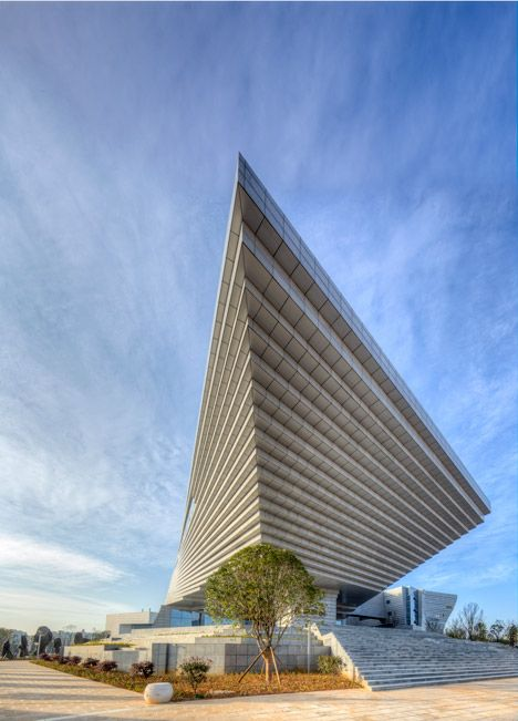 Qujing History Museum in China features a roof shaped like an upside-down staircase.