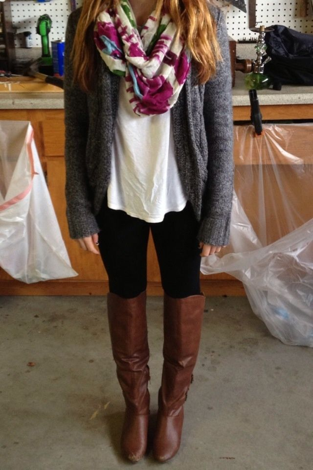 Gray sweater, white top, black leggings and brown boots