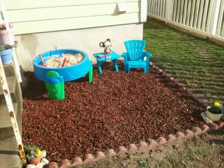 Made this area for my son today!  That is rubber mulch(like what's at a playground). This is all his :-)