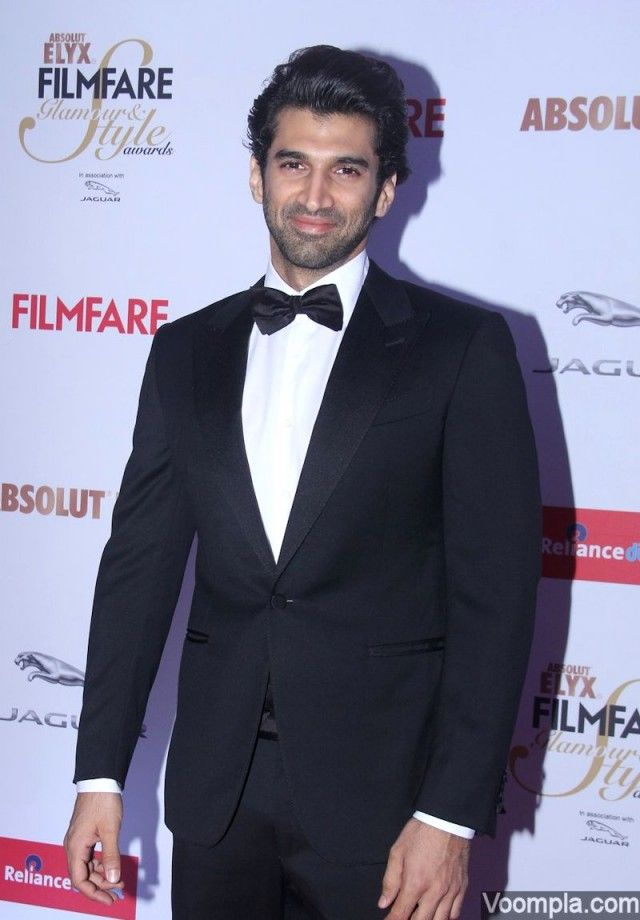 Aditya Roy Kapur looks dapper in a black suit, white shirt and a cute bow tie. via Voompla.com