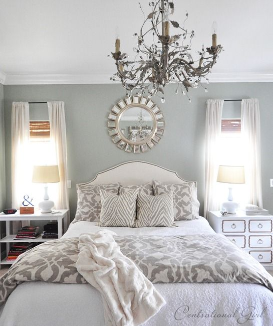 Love the color of the wall with the plain bedspread and the patterned comforter and mirror