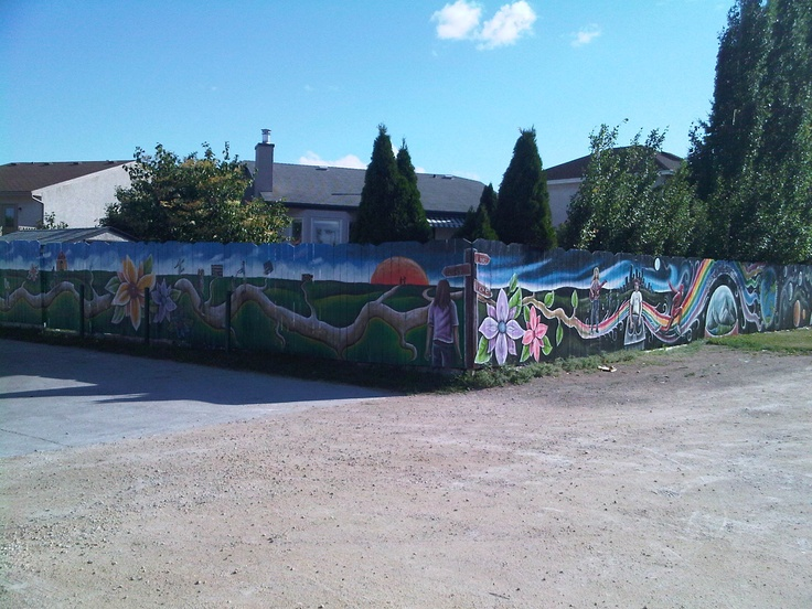We had this awesome Your Life, Unlimited mural painted on our fence. It makes me happy every time I drive home.