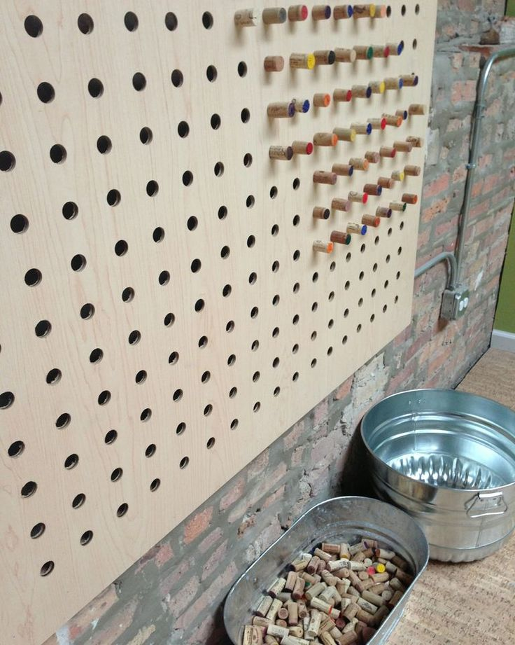 """Giant pegboard with cork 'pegs' - at 'The South Loop'... image shared by red tricycle ("""",)"""