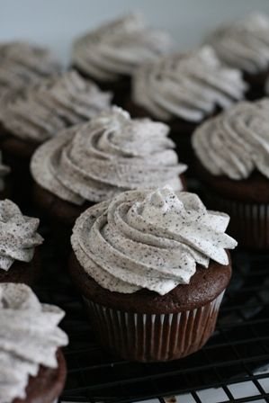Put the cream half of the oreo on the bottom of cupcake wrapper, mix fudge cake mix with a coke zero & bake....then use this frosting recipe....ah-mazing