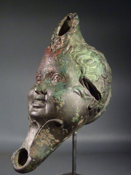 Early Roman bronze Satyr head oil lamp.      1st century BC – 1st century AD