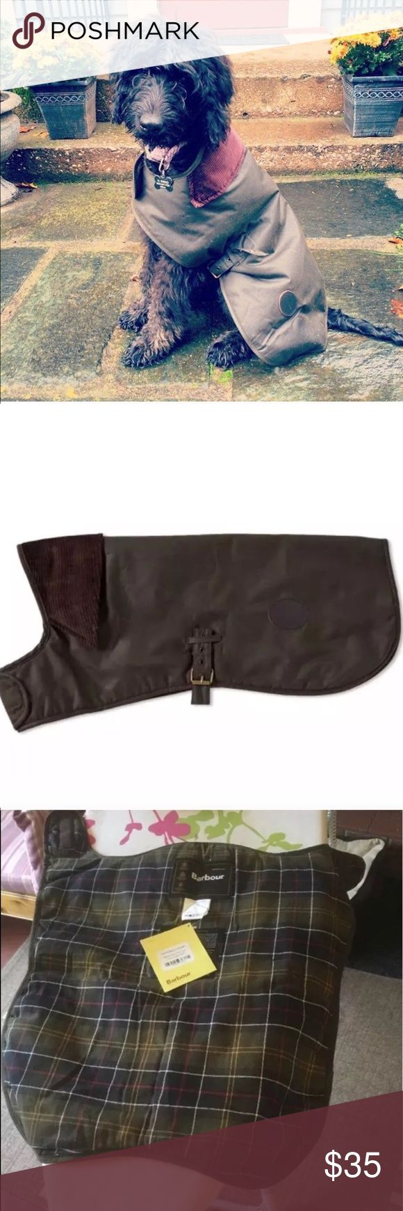 Barbour waxed cotton dog coat My dog wore this 2-3 times when she was a puppy and since outgrew it. Please not it is NOT NWT and was just photographed with the tag. Fits golden retriever sized dogs, up to 55 pounds. Great classic style for a great price! Barbour Jackets & Coats