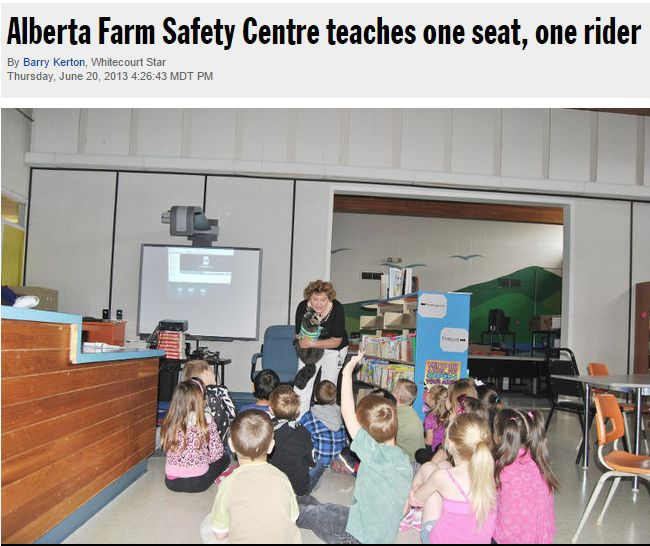 Lydia Hittinger and Casey Careful, a raccoon talk to Mrs. Britt's kindergarten class on Tuesday, June 11 about the dangers of riding on a quad or ATV. Barry Kerton | Whitecourt Star
