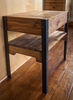 Hand made side table created out of repurposed pallet wood and metal legs. The wood is sanded lightly, but the nicks, dents and patina are left to give
