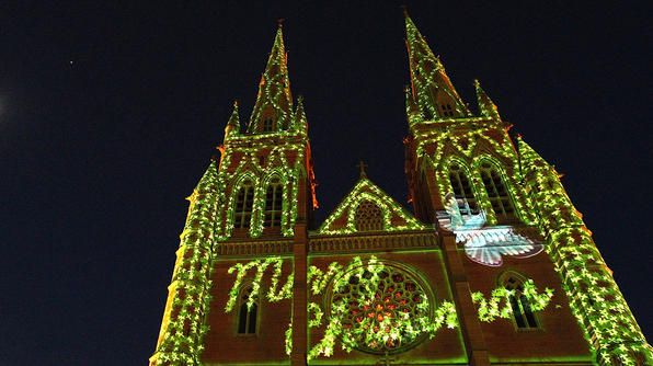 """SYDNEY, AUSTRALIA  The Christmas holiday falls during Australia's summer it is popular to go camping during this time. Natives decorate their homes with trees and lights, but also display bunches of """"Christmas Bush,"""" a native Australian tree with small green leaves and cream-colored flowers that turn red in summer. In each state capital, there is a """"Carols by Candlelight"""" service where famous performers sing holiday favorites."""