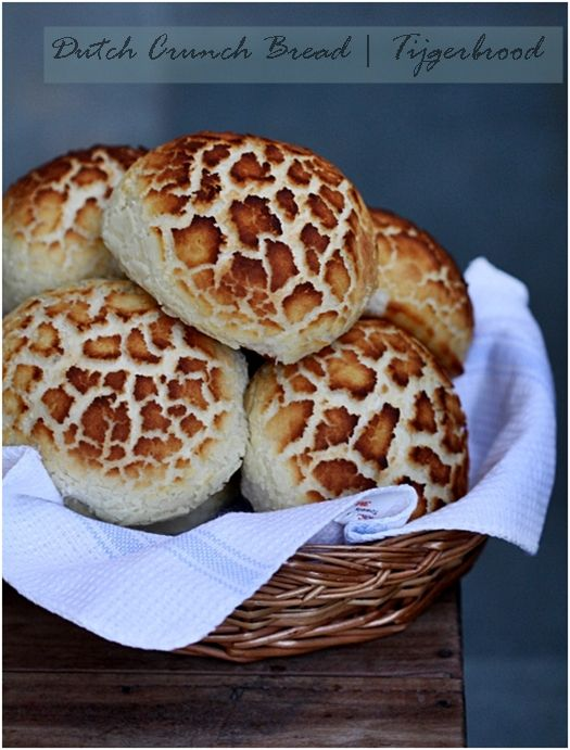 """Dutch Crunch Bread (Tijgerbrood). Technically, Dutch Crunch doesn't refer to the type of bread, but rather the topping that is spread over the bread before baking. In Dutch it's called Tijgerbrood or """"tiger bread"""" after the tiger-like shell on the bread when it comes out of the oven. The final product has a delightful sweet crunch to it that makes it perfect for a sandwich roll.   from passionateaboutbaking.com"""