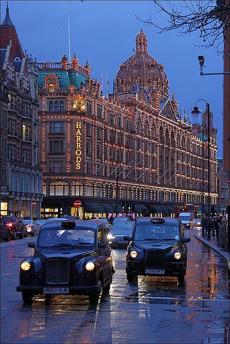 Harrods in London, the rain makes this photo look so pretty. I love all the white lights around Harrods. :-)