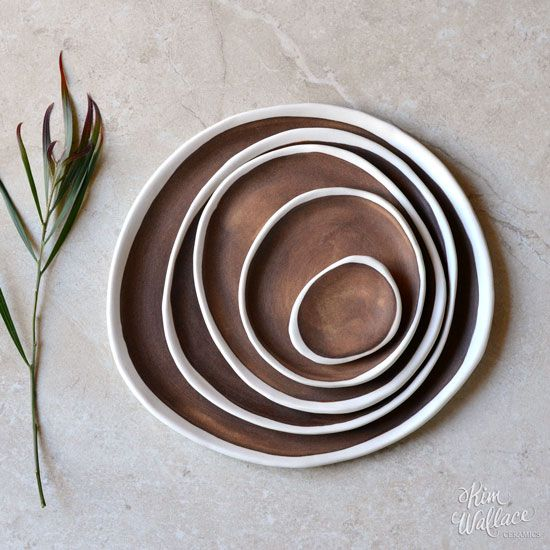 Kim wallace - Handmade ceramic pebble plate, made from white porcelain clay and hand-brushed with a stunning rust coloured glaze. Each piece is shaped and glazed entirely by hand, creating a gorgeous organic feel with no two pieces exactly the same.