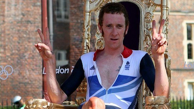Bradley Wiggins claimed a British record seventh Olympic medal with a sensational gold in the men's cycling time trial.