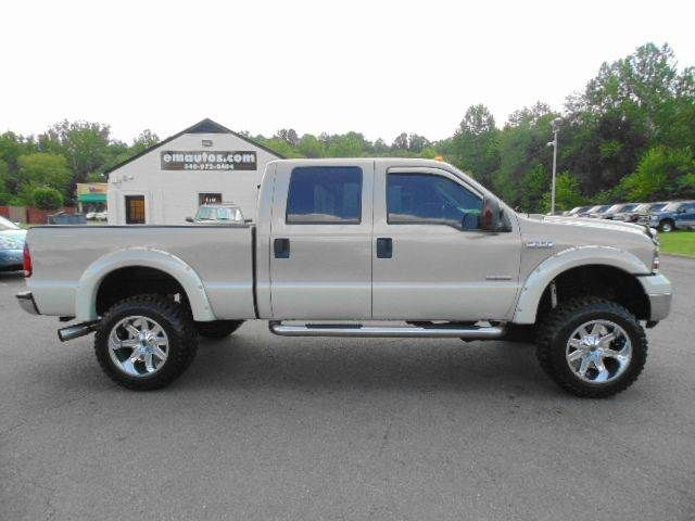 WWW.EMAUTOS.COM  2007 Ford F-250 Super Duty Southern Comfort Crew Cab 4x4 Short Bed DIESEL TRUCK FOR SALE In Locust Grove VA - E & M Auto Sales #Emautos #Ford #F250 #CrewCab #Diesel #Powerstroke #DieselTruck #LiftedTruck #SouthernComfort #ARP HEAD STUDS #35x12.5x20MASTERCRAFTTIRES #20x12XD PVD/CHROME TRAPS