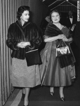 "A relaxed evening at the theater: The Queen Mother and Queen Elizabeth II arrive at Windsor's Theatre Royal for a performance of George Bernard Shaw's ""You Never Can Tell"" on February 23, 1962."