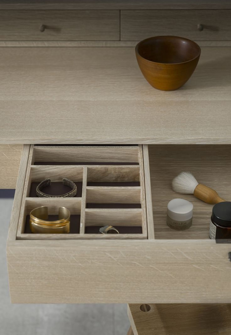 The Lana dressing table's lower lockable drawer houses a removable leather lined jewellery tray, and a drawer divider. The surface box consists of 3 smaller drawer sections and also features a hidden drawer and a cheval mirror.