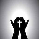 Praying hands with cross silhouette