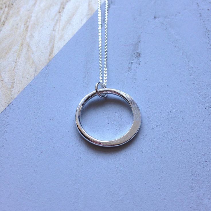 A personal favourite from my Etsy shop https://www.etsy.com/uk/listing/574432143/recycled-silver-pendant-semi-flattened
